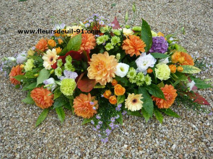Raquette tons rose livrable à Etampes,Lardy etrechy à l`église ou au funérarium